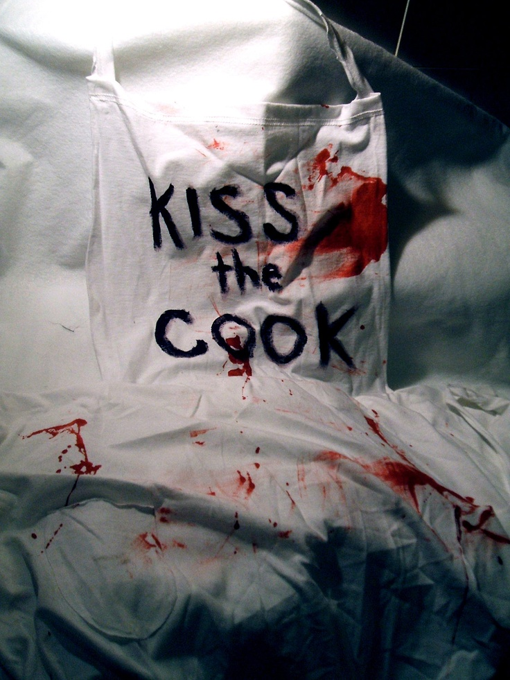 """Kiss the Bloody Cook. $8.00, via Etsy  --  This bloody apron was used in the Sincere Zombies Calendar photo shoot! Worn only once, it's ready for your ironic barbecue, or to finish off your outfit for a zombie walk!  Note: this piece is made from cotton and isn't a """"real"""" apron, so it won't protect you from much."""