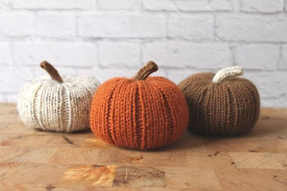 These three beautiful stuffed knit pumpkins are the perfect centerpiece or finishing touch for fall decorating or on a Thanksgiving table!  Knit in a beautiful pumpkin orange, rustic wheat, or chocolate brown, these squashy little pumpkins are stuffed with polyester fiberfill. Each pumpkin is approximately 12 around (see last picture, above) and 3.5-4 high including stem.  They can be purchased separately or altogether. If purchasing just one or two, please specify in the note to…
