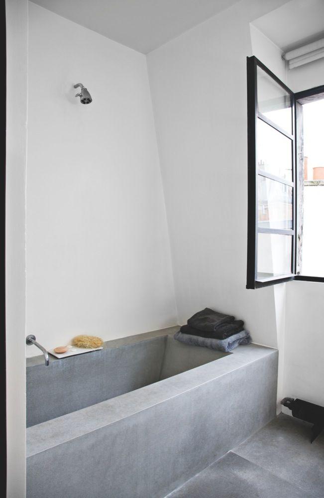 Minimal bath design with seamless integration of tub and floor.