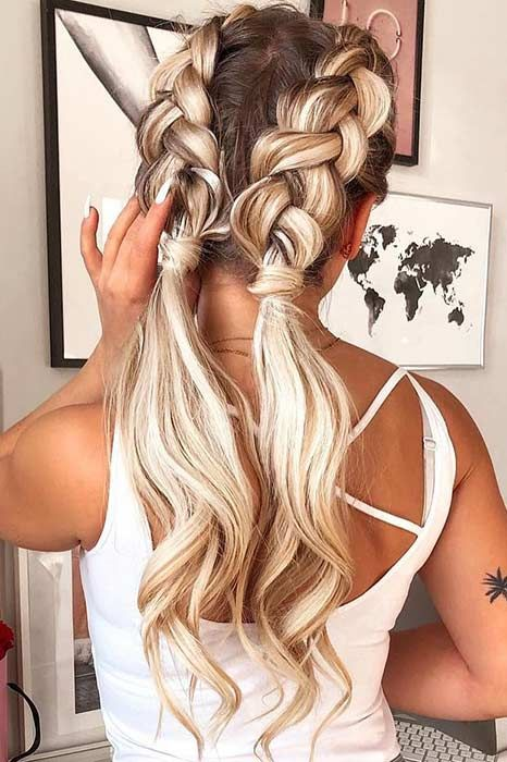 Two dutch braids with curly ends