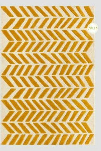Yellow rug from land of nod is so cute for a nursery
