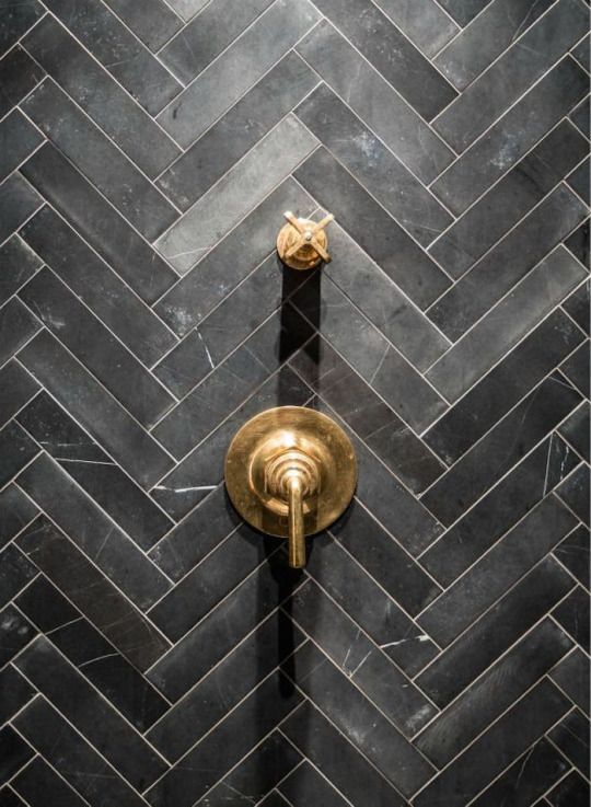 Charcoal coloured herring bone tiles and brushed gold handles