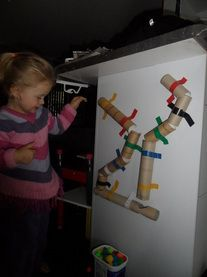 Paper tube Tunnels and pom poms -great for science, colour learning, fine motor skills