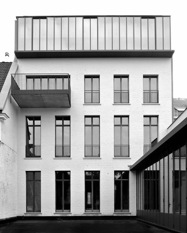 "KI Residential complex in Gent, Belgium by @vincentvanduysen | ""In the context of the urban centre of Ghent, a contemporary rooftop extension was added to an existing historic building. While the main volume was kept, due to its precious ornaments on the façade and interior, the rear façade and the roof were completely rebuilt. The new intervention was clad in a natural bluestone with a neutral colour to prevent a dominant element on top. The building now reads as a single cohesive…"