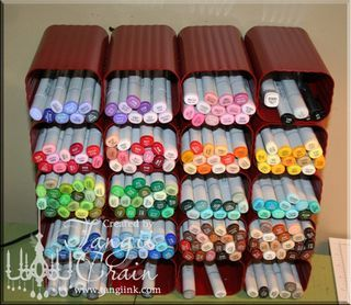 marker storage made from drain spouts... clever! inexpensive and expandable as your collection grows.