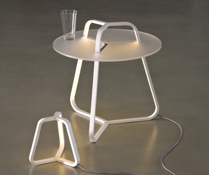 Table lamp, indirect diffused light, designed for Led bulb, 3000°K. Metal painted structure. Floor standing lamp, indirect diffused light, designed for Led bulb, 3000°K with satin methacrylate support plane of 50 cm diameter. Metal painted structure.