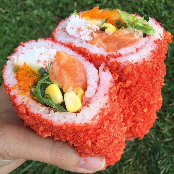 That's right. You can go somewhere, build your own poké burrito, and then they will roll it IN HOT CHEETOS. | Sushi Burritos Wrapped In Hot Cheetos Are Here, 'Cause Why Not