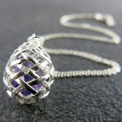Weave Medium Egg Pendant in Silver with Amethyst rough gemstones on the inside, and White Sapphire gemstones on the outside.