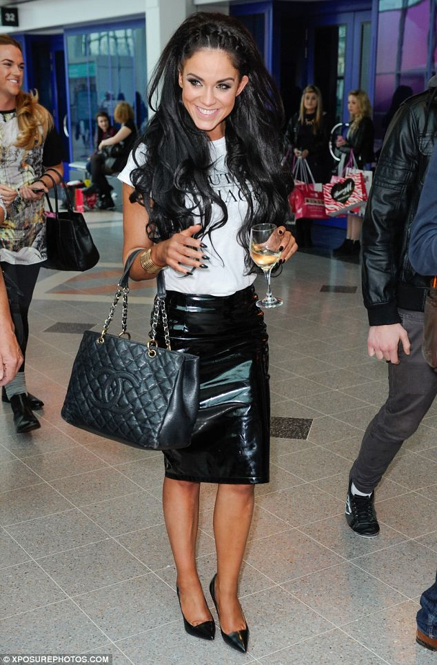 She deserves a Pat-tison on the back! Vicky shows off her newly slender figure in a PVC pencil skirt at Clothes Show Live