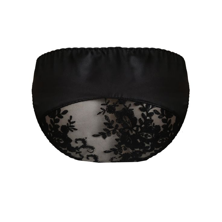 Ayten Gasson Lorna Silk Knicker: The classic black silk knicker featuring a risque lace panel along the bottom. 100% silk with a sheer lace panel featuring delicate black floral embroidery. Low-rise fit and designed to sit on the hips. Finished in the centre with a black satin bow. Complete the look with the Lorna Silk Soft Bra. Designed and handmade in our Brighton Boutique.