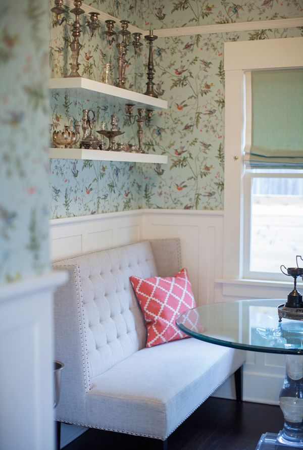 Dreamy breakfast nook. I love the old candlestick collection on the stark IKEA shelves.