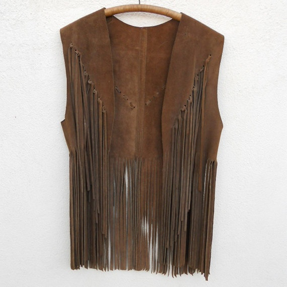 Vintage 60s Suede Leather FRINGED Hippie Vest. $54.00, via Etsy.    I would add beads to this gem!