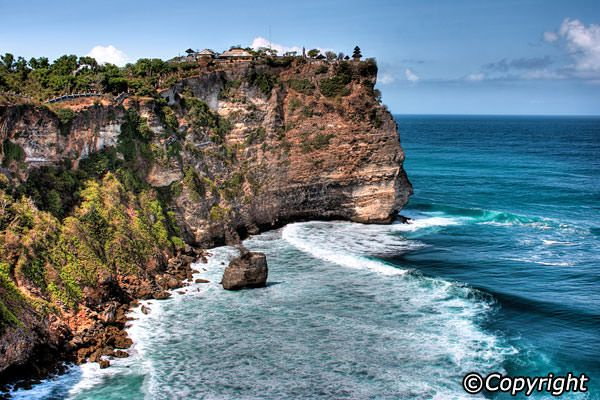 Uluwatu Temple, or Pura Luhur Uluwatu, one of six key temples believed to be Bali's spiritual pillars, is renowned for its magnificent location, perched on top of a steep cliff approximately 70 metres above sea level. This temple also shares the splendid sunset backdrops as that of Tanah