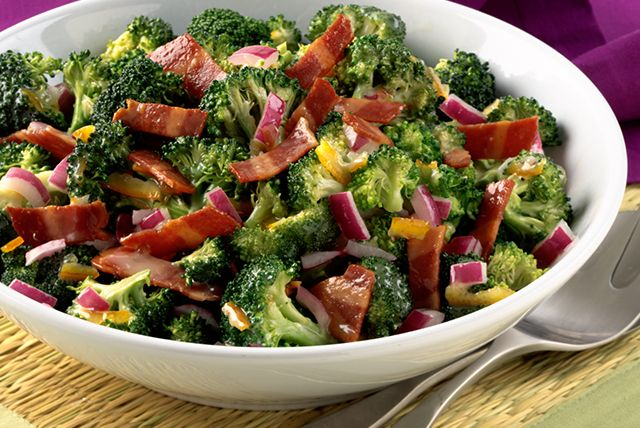 """SUNSHINE BROCCOLI-BACON SALAD—6 slices Bacon, cut into ½"""" pcs; ½ cup Mayo; 3 Tbsp Orange Marmalade; 2 Tbsp White Vinegar; 6 cups Broccoli Florets; ½ cup chopped Red Onions.  Cook & stir bacon until well done.  Mix mayo, marmalade & vinegar until blended.  Combine bacon with all remaining ingredients in large bowl.  Add may mixture & mix lightly.  Refrigerate 1 hour."""