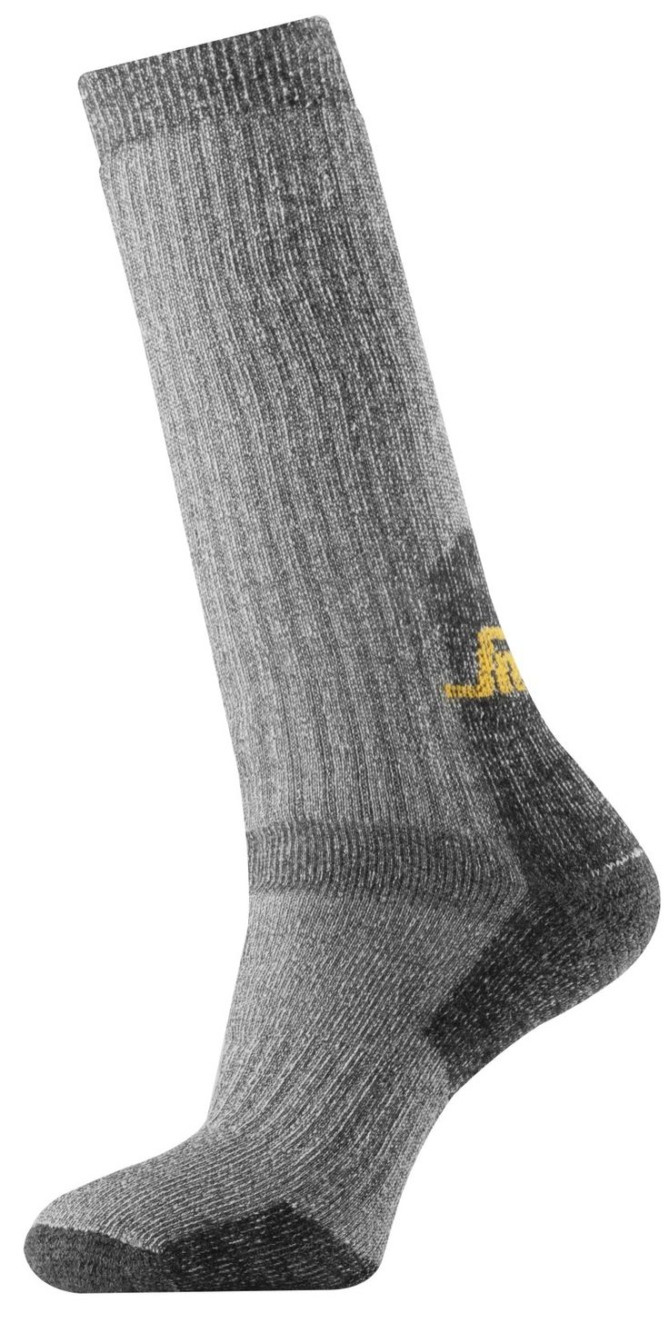 Forget cold feet. With these outstanding heavy wool socks, you can. High, thick, soft, reinforced and with a superior wool terry quality for extremely warm working comfort. - Snickers Workwear Artnr. 9210