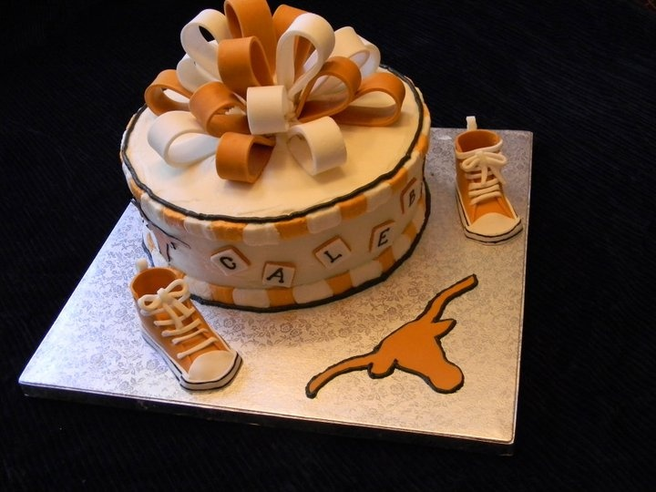 Texas Longhorn Baby Shower Cake - cake is covered in mmf.  The shoes are MMF and gum paste mixed together.  1st time I ever made the shoes.