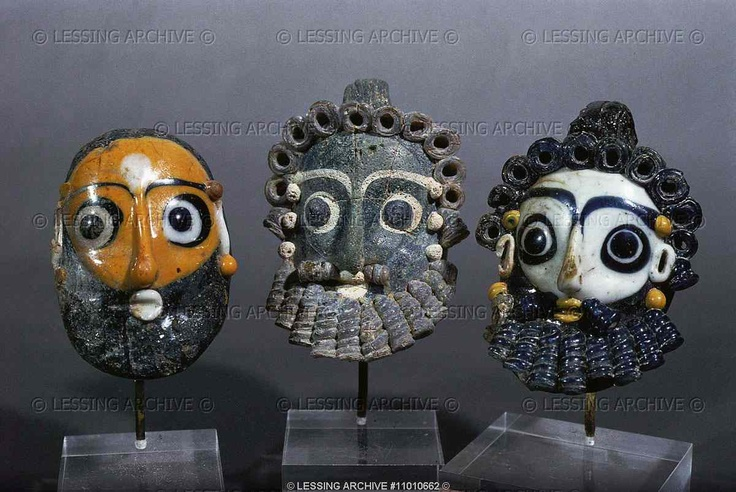 Three bearded head pendants,protective amulets. Sand-core glass (4th-3rd BCE) from Carthage, Tunisia 6 cm