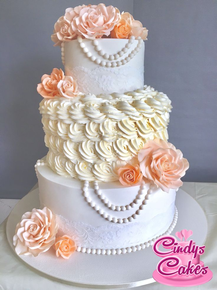 Apricot sugar flowers and piped rosettes for this pretty  #wedding #cake