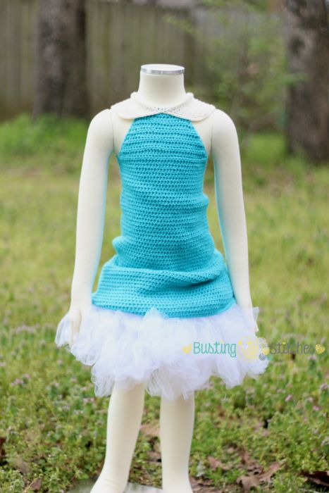 Make this Dainty Fairy Crochet Dress by Busting Stitches with Lion Brand Modern Baby! Cute for dress up, costumes, or anytime! Free crochet pattern calls for 4 - 5 balls of yarn and a 5mm crochet hook.