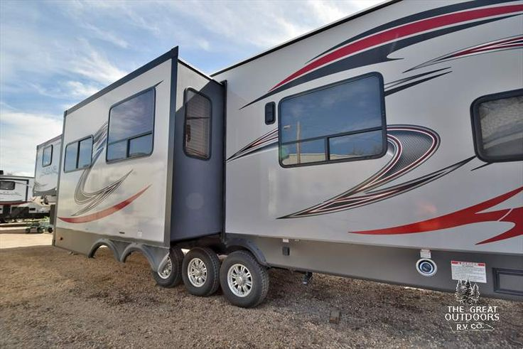 The Vengeance 377V is a functional toy hauler fifth wheel with the comforts of home. The 377V features solid surface countertops, a large 8 cubic foot fridge, and a stainless steel sink. You have a 12 foot garage, cargo ramp with patio option, diamond plate floor trim in the garage, fuel station, 5.5 Cummins Onan generator, and enclosed underbelly.