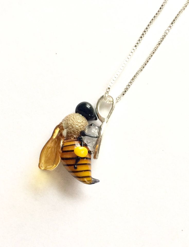 Handblown glass honey bee necklace, silver loop and chain, bee gift, glass bee, bee jewelry by TessaHillSculpture on Etsy https://www.etsy.com/listing/592315135/handblown-glass-honey-bee-necklace