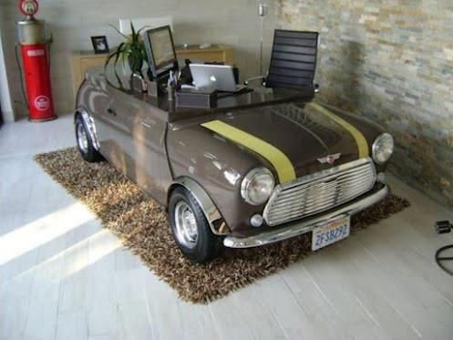 mini cooper into desk... definitely interesting or is that too funny?