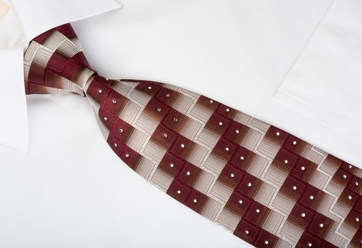 Elegant Rhinestone necktie perfect for every occasion handmade and designed by top brand name Pierre Cardin. Presenting a stylish Burgundy, Silver Chevron Checkered design and sparkling with white Rhinestones.