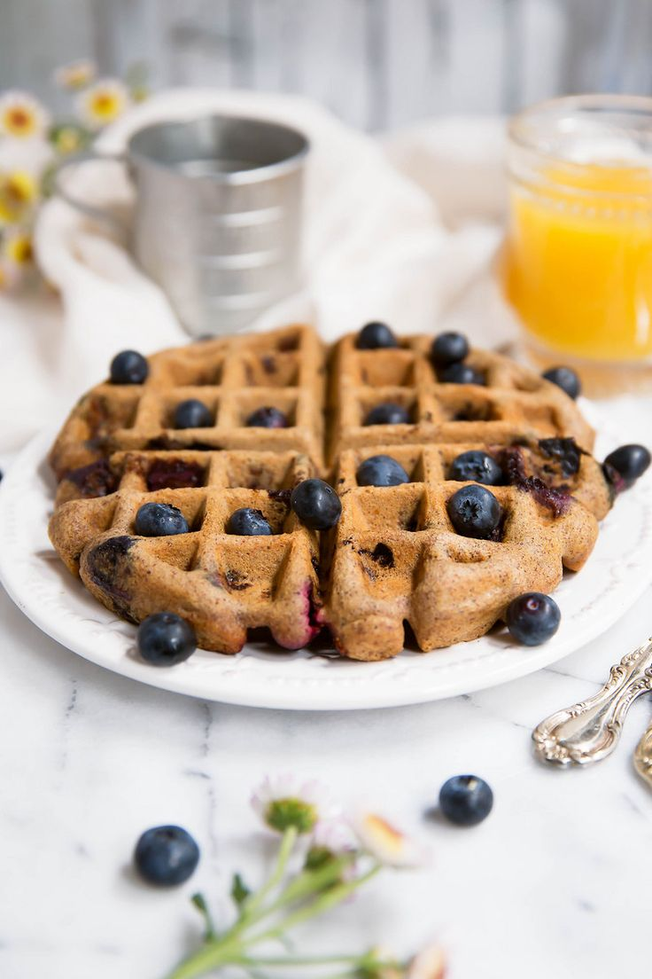 Blueberry paleo waffles made with almond butter and just a tiny bit of coconut…