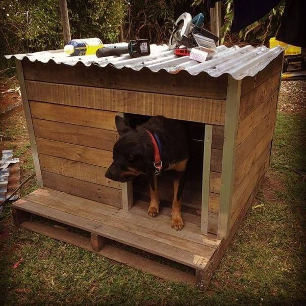 It is our first idea in this project which is shown in this picture and it is a beautiful wooden pallet dog house which is made from the pallets and it is placed in the garden outdoor place. It is very simple wooden pallet idea which you can use in your home if you have a pet like dog. And here your dog can take rest and can playing in his own house.
