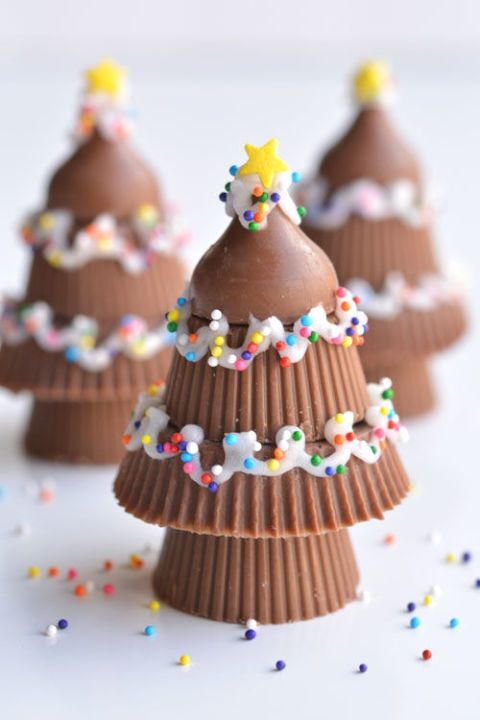 Peanut Butter Cup Christmas Trees:  Stack a fewmini peanut butter cupsand top with a Hershey kiss for a perfectly-shaped christmas tree. #christmas #holiday #easyrecipe #recipe #food #ideas #treats #christmastreats