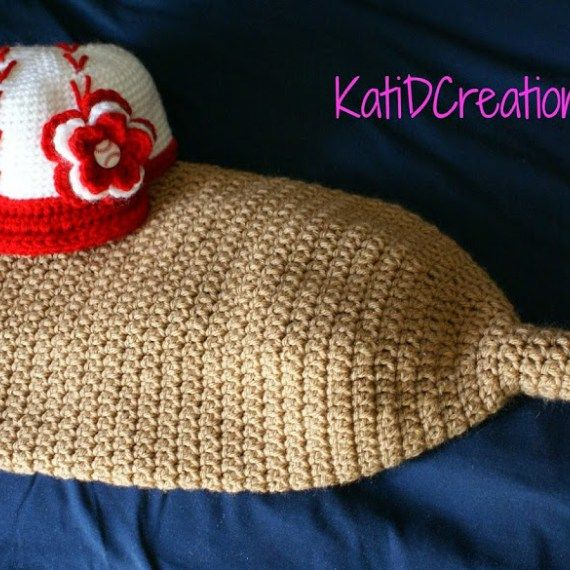 This is a super cute baseball bat cocoon and baseball hat. Free hat size, and help with getting the stitching done just right.