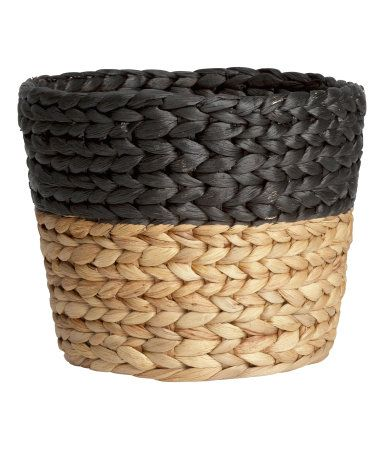 Braided storage basket made from water hyacinth. Diameter 7 3/4 in., height 7 in.