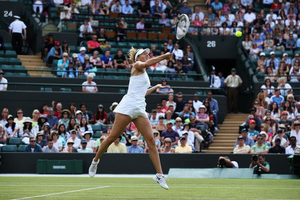Maria Sharapova Photos - Maria Sharapova of Russia plays a forehand during her Ladies' Singles first round match against against Samantha Murray of Great Britain on day two of the Wimbledon Lawn Tennis Championships at the All England Lawn Tennis and Croquet Club at Wimbledon on June 24, 2014 in London, England. - Wimbledon: Day 2