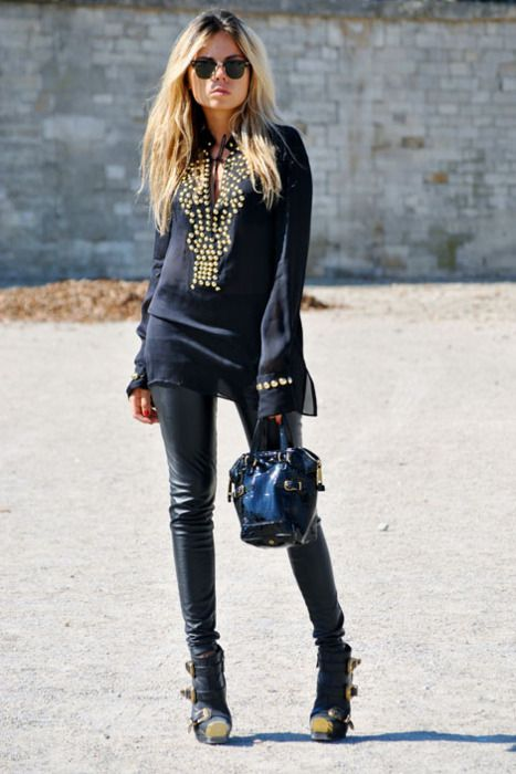 Erica Pelosini's sports a Givenchy top and bag, and Alexander McQueen boots.