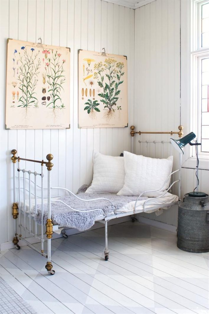 Analizzare: Wooden floors painted in soft-toned checker flow into paneled walls. Botanical prints accentuate vintage furniture for a look that is effortlessly elegant and drenched in sun.