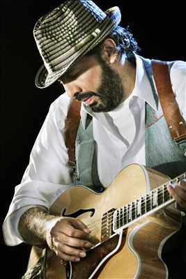 Juan Luis Guerra.  I don't even recall how I came to know this artist, probably on one of those music sites that tell you if you like so-and-so, you may like this artist.  Well, I do.  For those not yet initiated into latin music, especially outside the Mexican corridas or mariachis, take a listen to Juan Luis Guerra.  You can appreciate it even if you don't understand Spanish.  His song-writing is wonderful, too, if you can understand Spanish or get a translation.  Get ready to move!