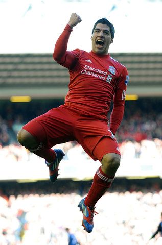 Liverpool's Luis Saurez celebrates after scoring the first goal of the game for his side during their English FA Cup quarterfinal soccer match at Anfield Stadium, Liverpool, England, Sunday March 18, 2012. (AP Photo/Clint Hughes)