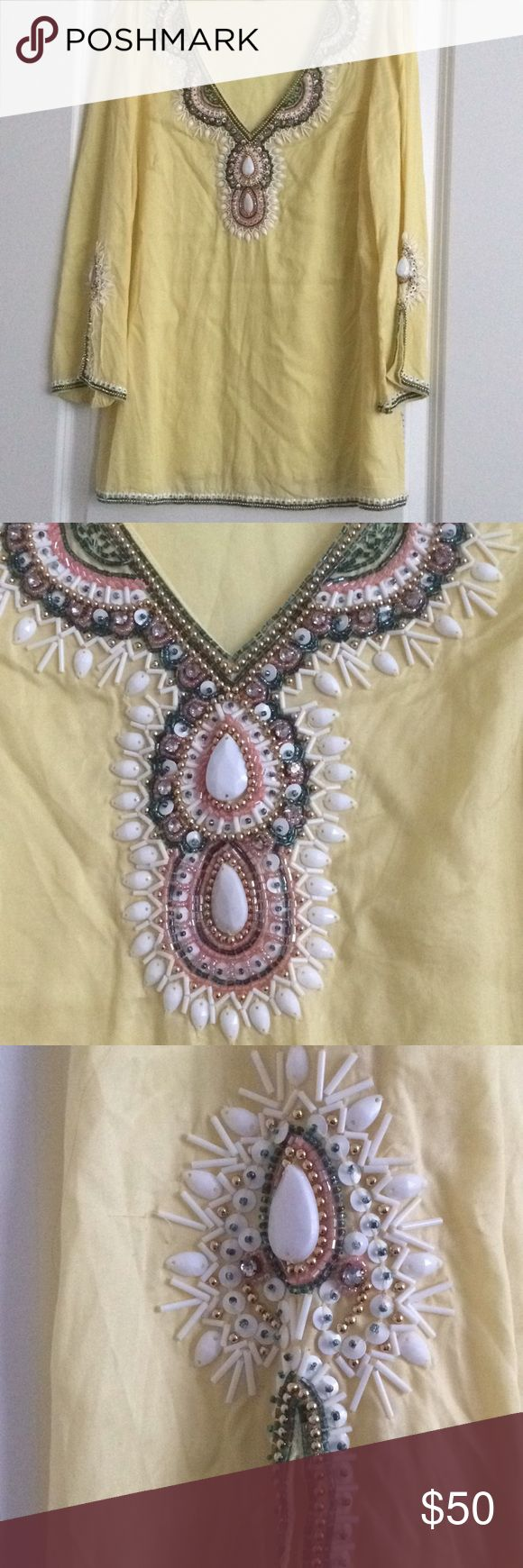 Lilly Pulitzer Yellow Beaded Embellished Tunic S Beautiful yellow Tunic top with white, gold, blue and pink beading. Only missing bead I could find was one long bead on the right sleeve, however due to the heavily embellished nature there may be other small bears missing that I haven't noticed and I tried to photograph as much as possible. It's in great condition and flattering and flowy on! Lilly Pulitzer Tops Tunics