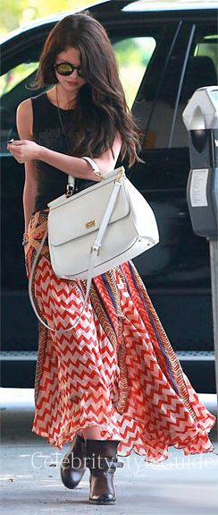 Selena Gomez and Free People Maracana Silk Skirt, Free People Spellbound Ankle Boot, Dolce & Gabbana Miss Sicily Bag. See the latest Selena Gomez style, fashion, beauty, trends, wardrobe and accessories. View ratings and vote on Selena Gomez style and fashion.