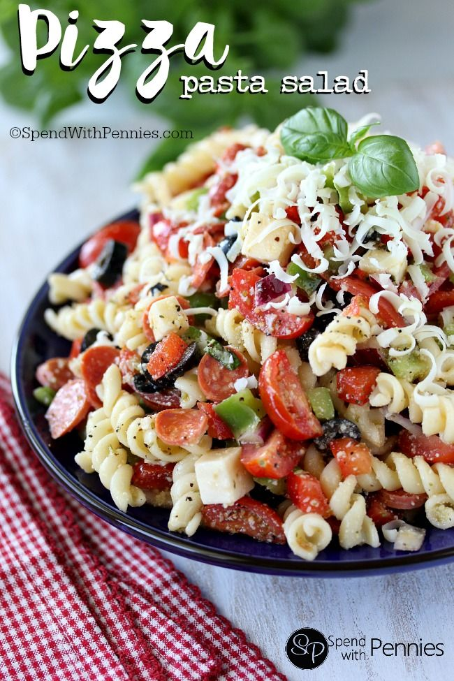 Pizza Pasta Salad is one of our favorite cold salads and the perfect summertime lunch or dinner!  With an easy homemade dressing that takes just 30 seconds to make this pasta salad is loaded up with our favorite pizza toppings!