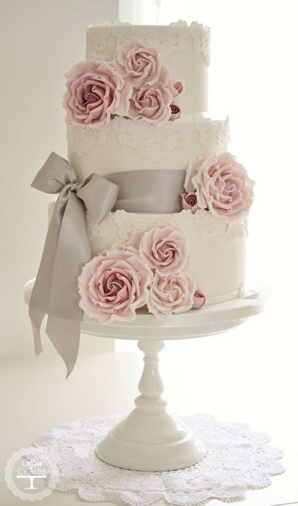 pink and gray wedding cakes with lace and ribbon