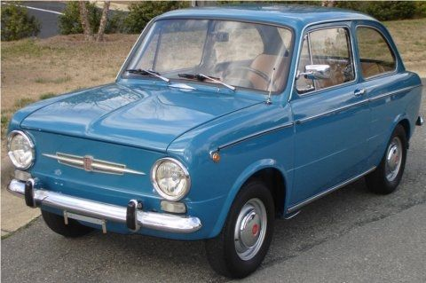 "Fiat 850!!  My first car was just like this, only maroon.  It needed a warning lable:  ""Not intended for use in the United States"".  What a bomb!!"
