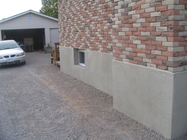 Parging applying a mortar coat to control leakage in masonry basement or foundation walls