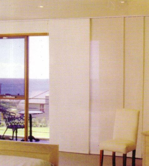Panel Blinds for sliding doors to deck. Match colour and fabric to other blinds in living area