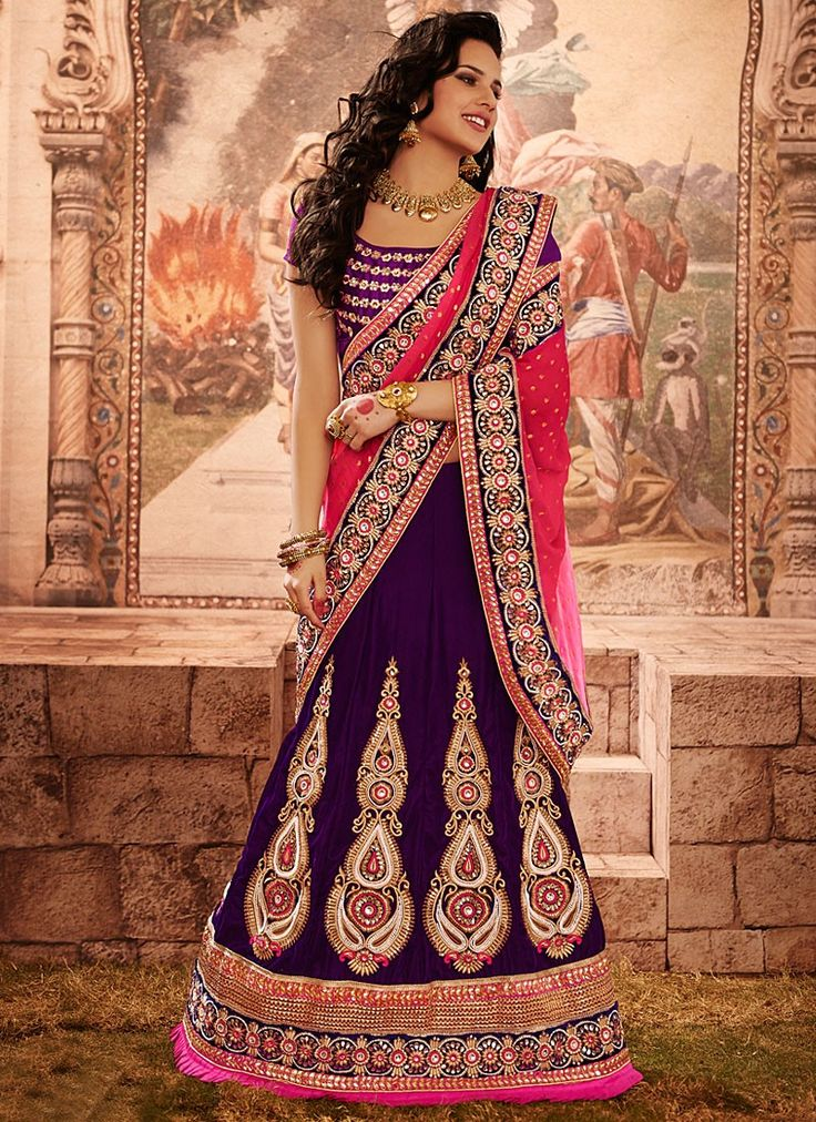 Shop this product from here.. http://www.silkmuseumsurat.in/purple-resham-work-velvet-lehenga-choli?filter_name=4633  Item :#4633  Color : Purple Fabric : Velvet Occasion : Bridal, Party, Reception, Wedding Style : A Line Lehenga Work : Applique, Embroidered, Patch Border, Resham