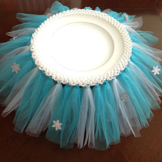This tutu will stand out on your party table! It is made with tulle to match you princess theme (teal blue and white glitter tulle). This can