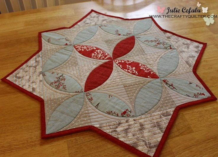 Winter Seeds Table Topper | This Christmas table topper combines applique with gorgeous cathedral windows patterns!