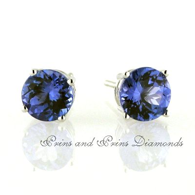 18ct white gold tanzanite 4 claw stud earrings. 2x 1.00ct round brilliant cut tanzanites are set in a classic claw.  We have a wide selection in our showroom. Contact us to ask for quotes on various sizes.