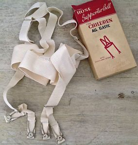 Jarretelles pour enfant dans sa boîte d'origine. 1950-60