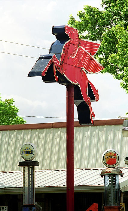 Route 66. Old pumps and Pegasus on old Rt. 66 in Rolla, Missouri. Who remembers seeing the flying horse at gas stations as a kid?